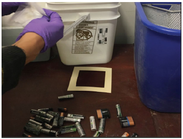 Students sample surfaces for metals at an electronic recycling facility