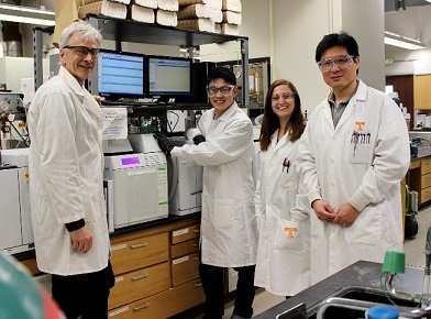 Researchers involved in the study, including Loeffler, in the lab.