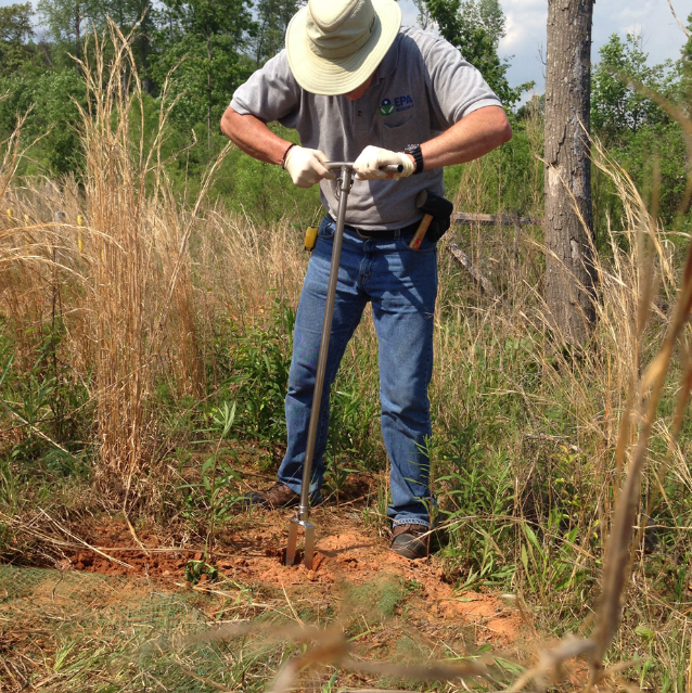 Researchers collecting soil samples.